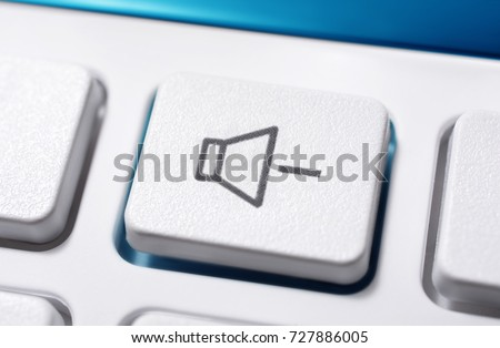Close Up Of A White Volume Down Button Of A White Remote Control For A Hifi Stereo Audio System #727886005