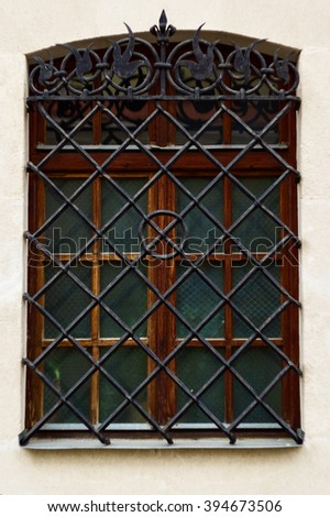 close up of a window with metal grill #394673506