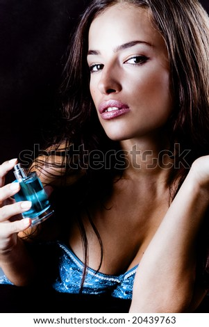 close up of a woman and pefume