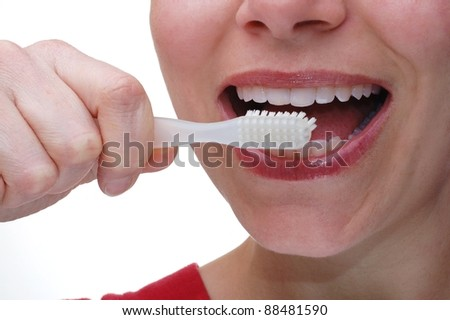 Close up of a Woman Brushing her Teeth