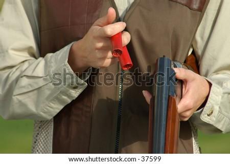 close up of a woman loading a shotgun