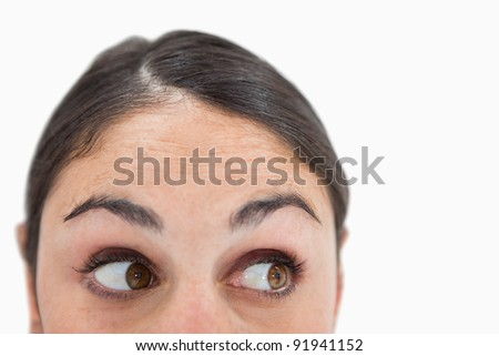 Close up of a woman looking away from the camera against a white background #91941152