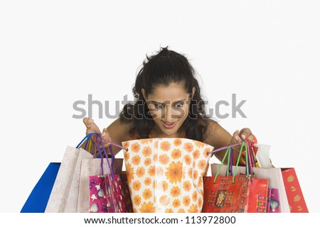 Close-up of a woman looking in shopping bags