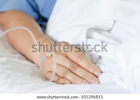 Close up of a woman patient in hospital with saline intravenous (iv)
