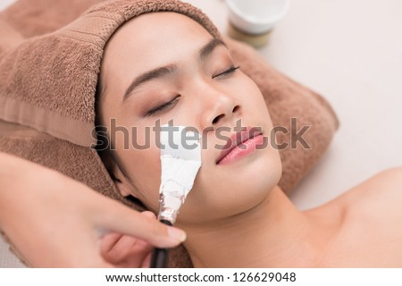 Close up of a woman's face having face mask