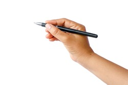 Close-up of a woman's hand holding a pen and writing gesture on a white background with the clipping path.