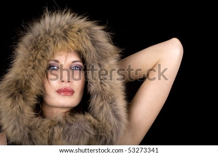 Close-up of a woman with an expensive fur coat