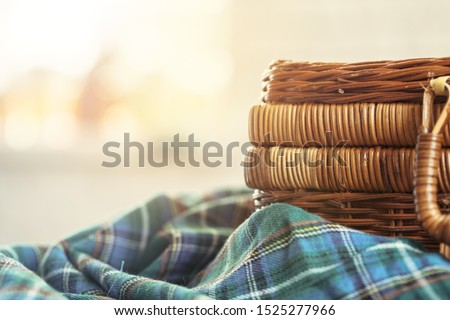 Close up of a wooden basket with dishware on white table Stok fotoğraf ©