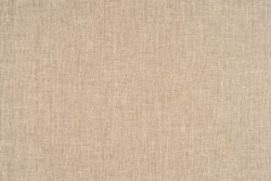 close up of a woolen fabric of beige color. Abstract background, empty template.