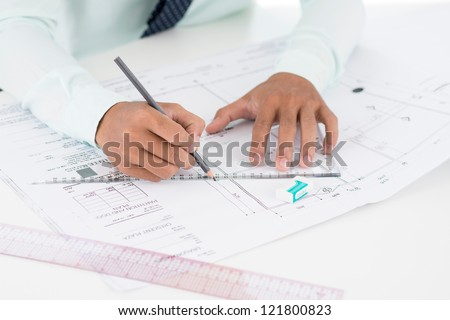 Close-up of a worker developing the design of a civil building