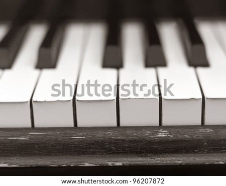 Close up of a worn piano