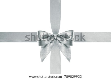 close up of a Xmas satin silver ribbon bow with crosswise ribbons on white background #789829933