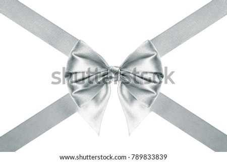 close up of a Xmas silk silver ribbon bow with crosswise ribbons on white background #789833839