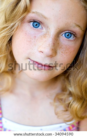 close up of a 10 year old girl with big blue eyes