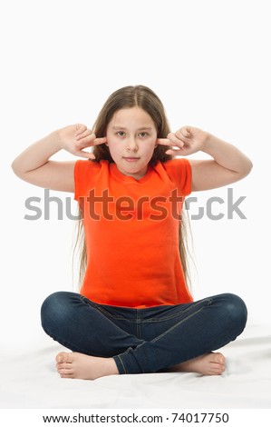 close-up of a 10 year old girl with fingers in her ears