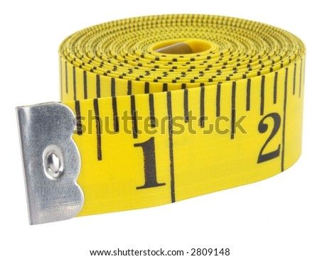 Close-up of a yellow measuring tape isolated on white.