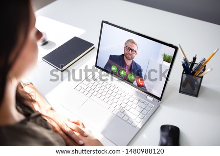 Close-up Of A Young Businesswoman Chatting With Her Colleague