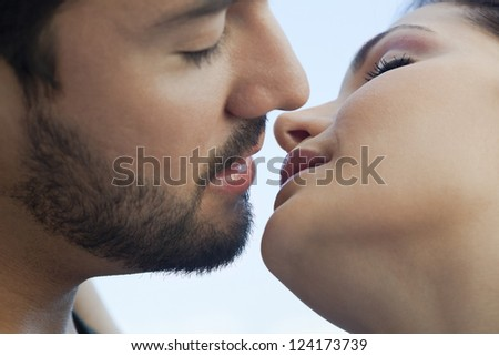 Close-up of a young couple romancing