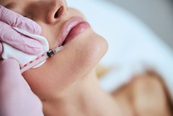 Close up of a young female patient undergoing a non-invasive cosmetic treatment in a beauty clinic