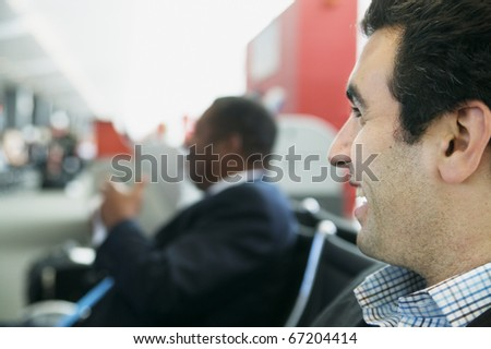 Close-up of a young man sitting in an airport