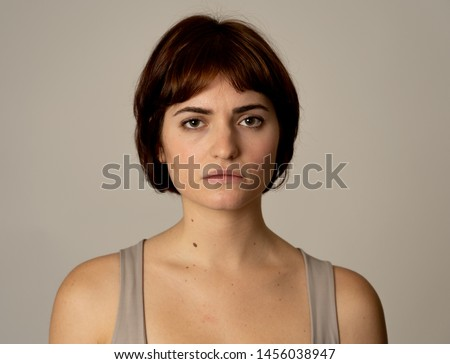 Close up of a young sad woman, serious and concerned, looking worried in emotional pain. Feeling sorrow and depression. Isolated in neutral background. In facial expressions and emotions concept. #1456038947