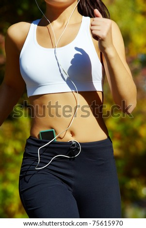 Close-up of a young woman jogging