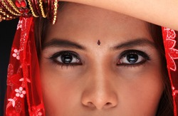 Close-up of a young woman's beautiful face in dancing costume