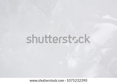 Close up of abstract frozen background of ice structure. Beautiful winter backgrounds with icy frost patterns. Picture of ice blocks from icebreaker a ship designed for breaking a channel through ice.