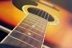 Close up of acoustic guitar, vintage filter.