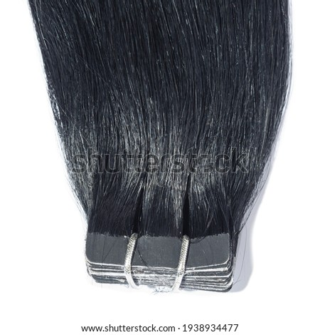 close up of adhesive tape in straight pitch black remy human hair extensions Photo stock ©