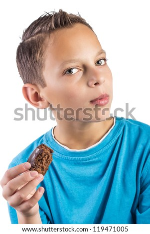 Close up of Adorable boy eating cookies