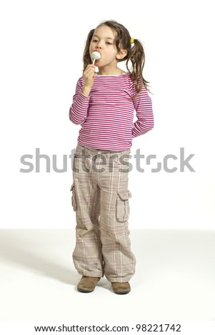Close-up of adorable little girl with a lollipop - stock photo