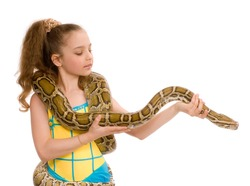 close-up of adorable young girl holding pet python on her shoulders, isolated on white background