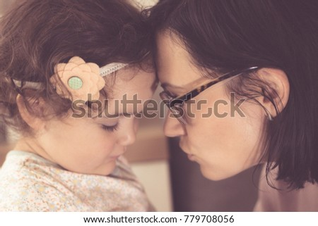 Close up of affectionate mother and daughter talking face to face.  #779708056
