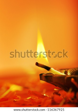Close up of aflame of an indian lamp - stock photo