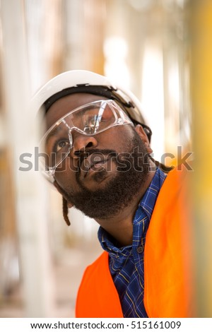Close up of African american construction worker. Low angle view #515161009