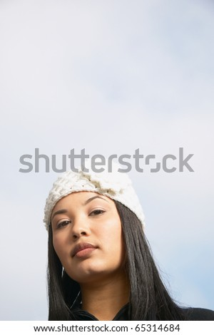Close up of African American woman wearing hat