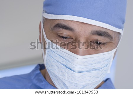 Close up of African male doctor with surgical mask