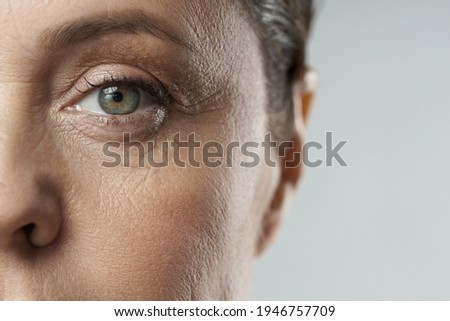 Close-up of aged female eye. Rejuvenation or Ophthalmology concepts. Сток-фото ©
