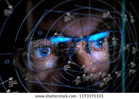 close up of air traffic controller looking at screen selective focus #1193195101