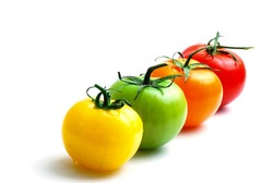 close up of alignment of multicolored tomatoes