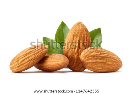 Close-up of almonds with leaves, isolated on white background