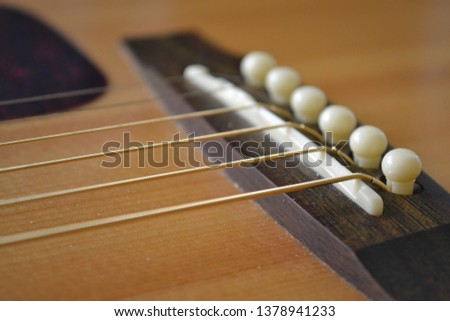 Close up of an acoustic guitar #1378941233