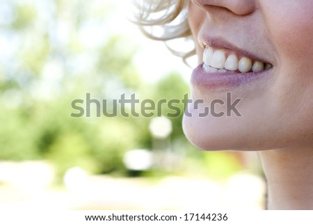 Close-up of an adult white woman smiling
