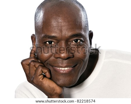 Close-up of an afro American handsome man with hand on chin smiling in studio on white isolated background