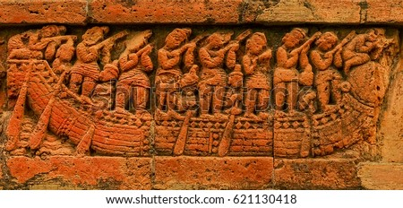 Close up of an ancient hand crafted Terracotta tile, sculpted on which is a story in Hindu scriptures. These Terracotta tiles can be found on the outer walls of the temples in Bishnupur, West Bengal.