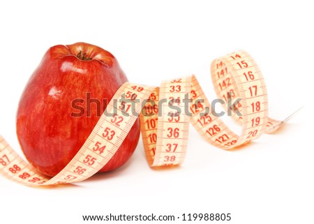 Close-up of an apple with a measuring tape around it