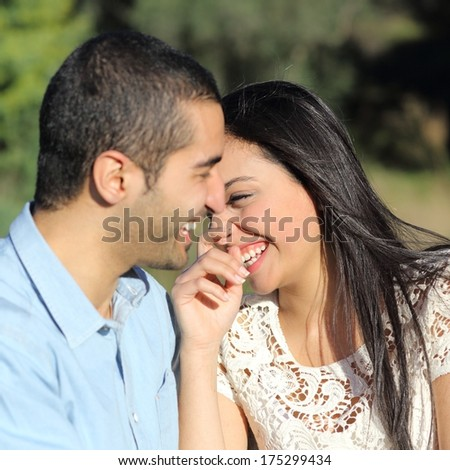 Close up of an arab casual couple flirting and laughing happy in a park #175299434