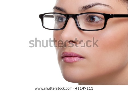 Close up of an attractive female wearing black glasses looking out of frame