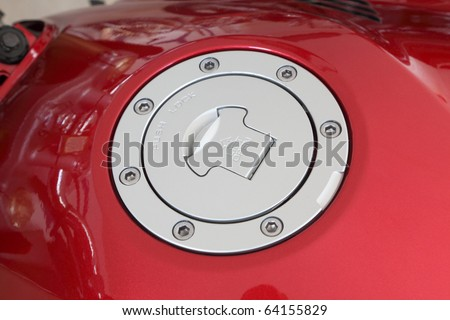 Close up of an  cap on fuel tank of modern motorcycle
